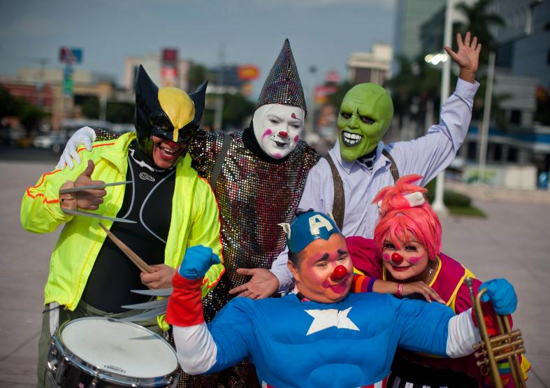 Clowns pose for a picture during the VI Laugh Festival in San Salvador, El Salvador on May 20, 2014. AFP
