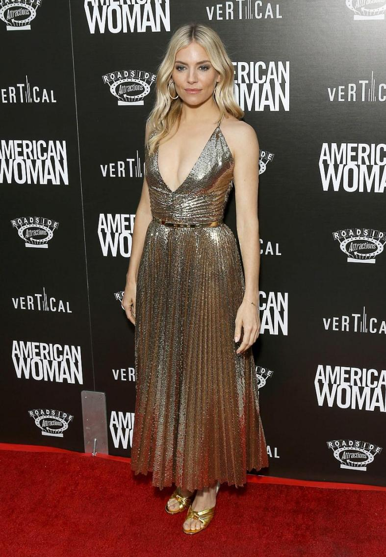 Sienna Miller is a goddess in gold