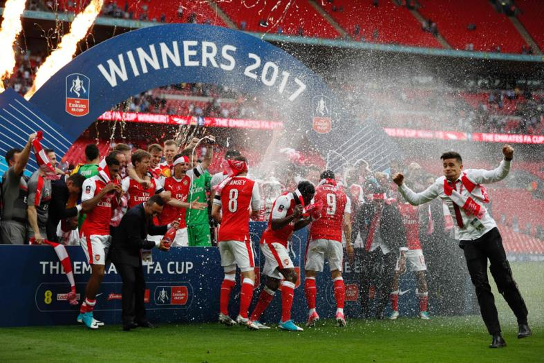 The champagne is sprayed as Arsenal's players celebrate after their win over Chelsea