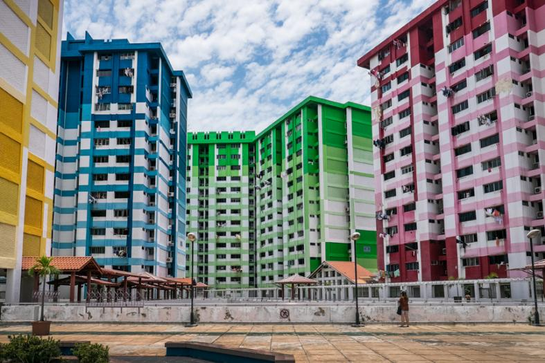 A passerby taking snapshots of the iconic colourful blocks at Rochor Centre. These colourful blocks will be slated for demolition at the start of 2017.
