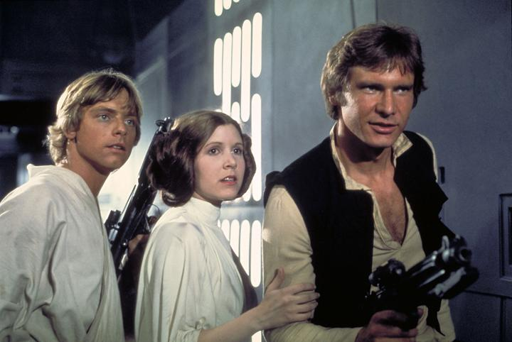 Mark Hamill as Luke Skywalker, Carrie Fisher as Princess Leia and Harrison Ford as Han Solo in Star Wars (1977)