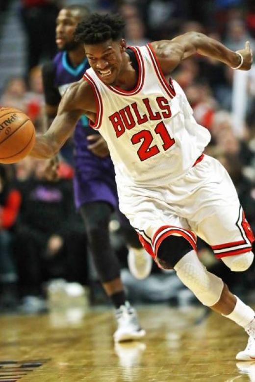 Jimmy Butler #21 of the Chicago Bulls chases down a loose ball against the Charlotte Hornets