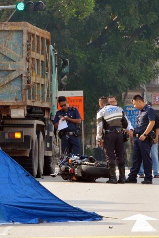 Biker run over by tipper truck