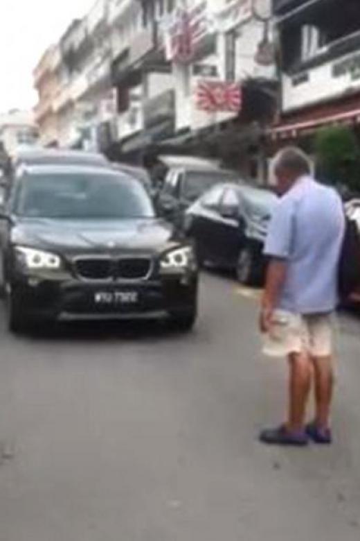 Elderly blind man in KL demands money to get off the road