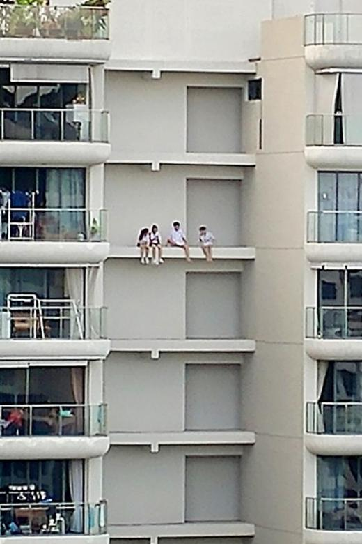 Teenagers put their lives on the edge of 16th-storey ledge