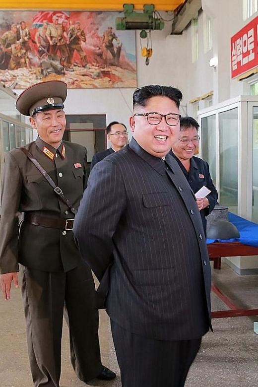 North Korea puts missile plans on show, steps up production