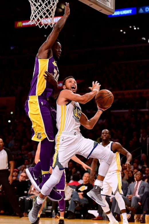 Stephen Curry lifts Golden State to over-time win against LA Lakers