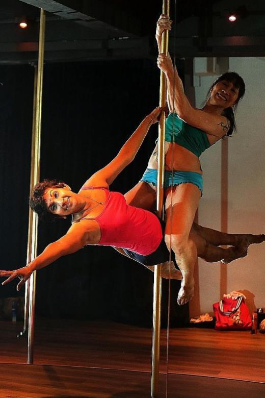 Breast cancer survivors perform pole dance