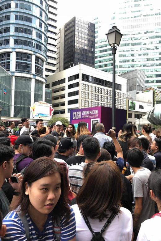 Huge crowd forms at Raffles Place for 'cash vending machine'
