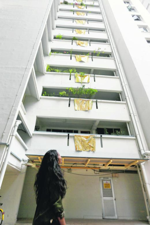 'Golden staircase' artist's 'golden' flags removed after complaints