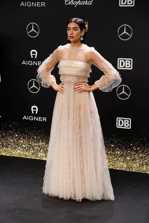 Lily Collins leads the way in glam festive dressing