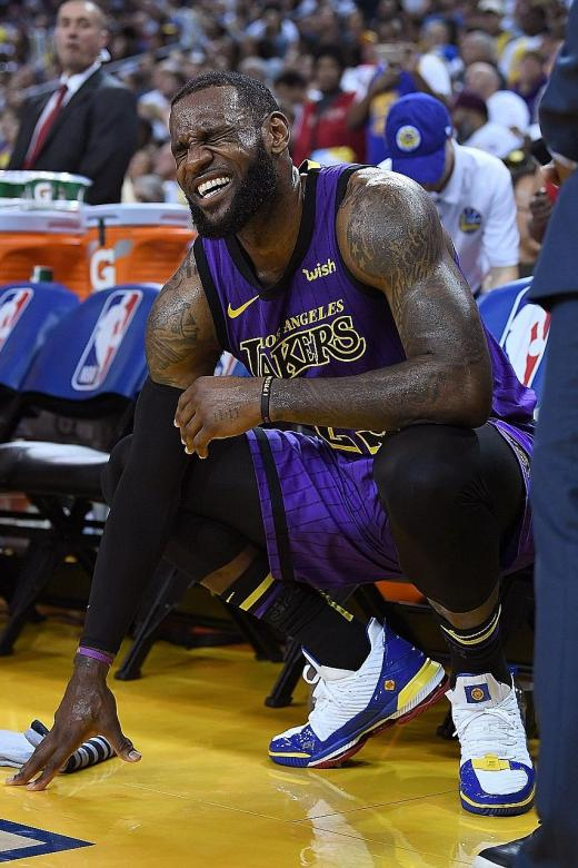 James injured in Lakers' rout of Warriors