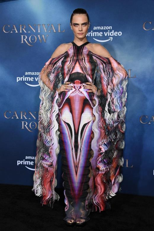 No couture is too difficult for Cara Delevingne to carry