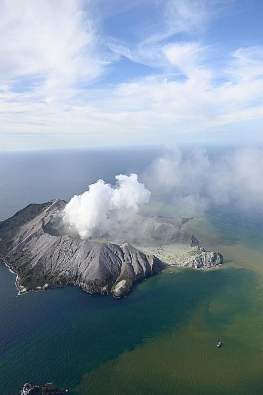 New Zealand volcano erupts, killing at least five, many still missing