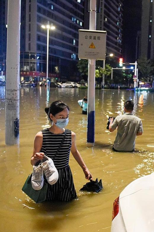 78 dead or missing in China storms and floods