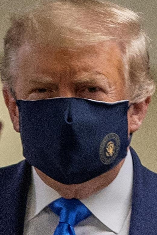 Trump finally wears mask as US posts record spike in coronavirus cases