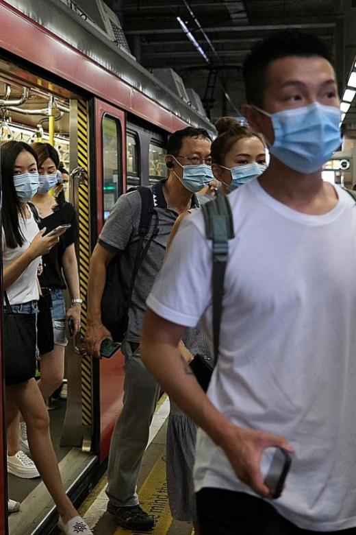 Hong Kong leader says virus spreading out of control in city