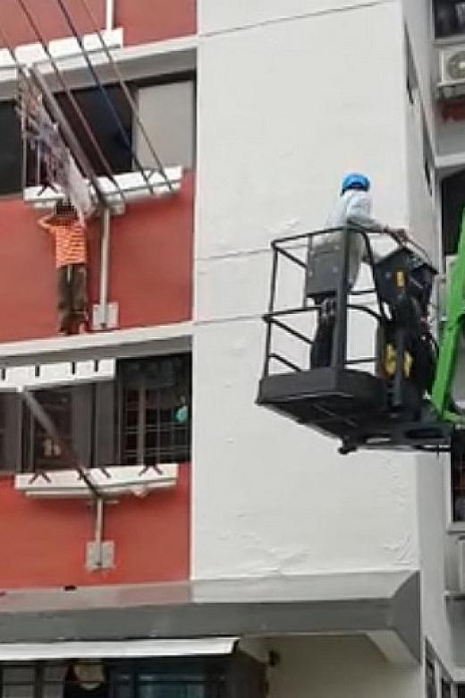 Worker saves 6-year-old boy trapped on ledge of block