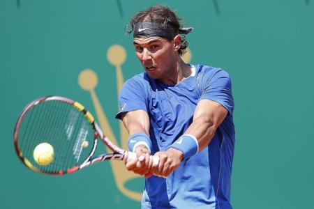 Nadal passes clay landmark