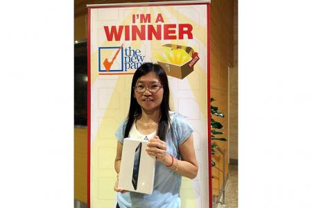 She wins prize for her family The New Paper Bonus Challenge winner gets iPad mini