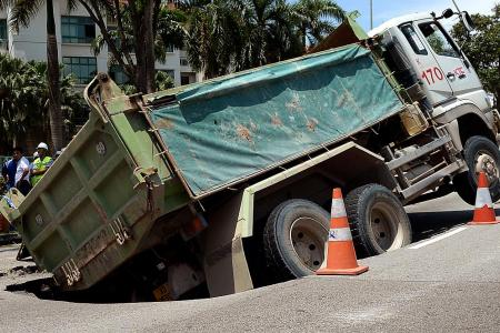 Lorry sinks into road