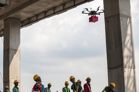 Drones used to bring smiles to foreign workers