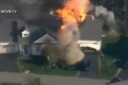 US cop shot dead, suspect's house explodes
