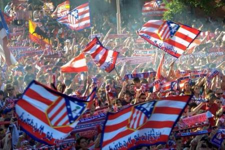 Fans of Atletico Madrid turn streets of Madrid white and red