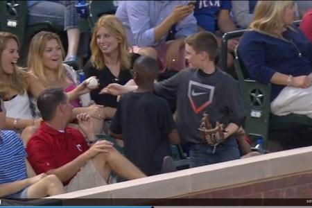 Boy gives baseball to impress woman who does not know it was a switcheroo