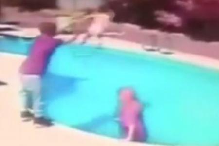 Shocking video: Dad throws toddler into pool