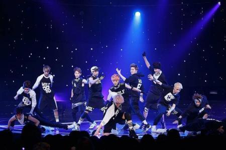EXO bandmates, critics cross as Kris quits