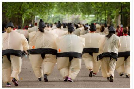 Man in sumo suit knocks himself out