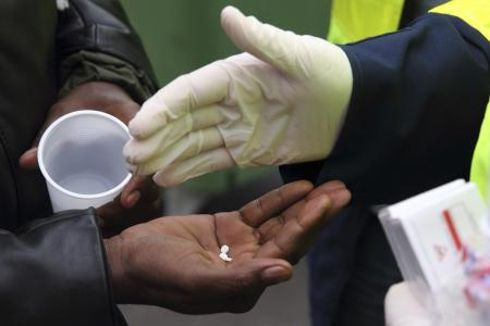 French police expel migrants from camps after scabies outbreak