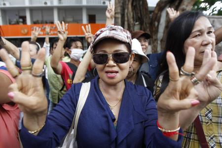 Thais flash Hunger Games three-fingered anti-coup gesture in protest