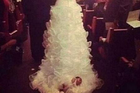 VIDEO: Woman gets married with her baby tied to her wedding train
