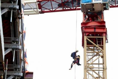 Sick crane operator rescued from 13 storeys high