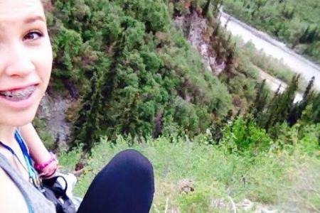 Teen falls off cliff while talking to mum