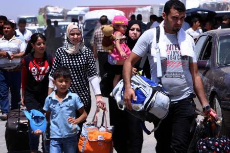 Jihadists take over Iraq town as half  a million people flee