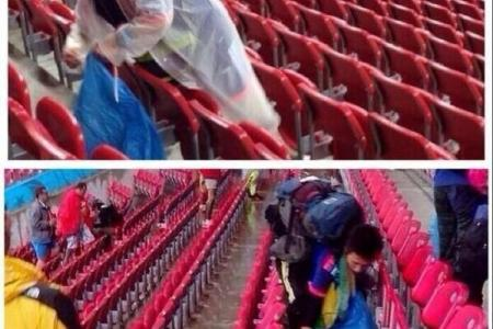 Japanese fans clear litter after match against Ivory Coast