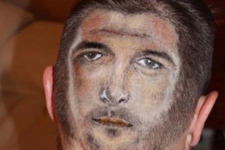 Over-enthusiastic England fan gets really creepy haircut