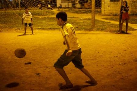 Sao Paulo slum kids challenge World Cup winners to play with them