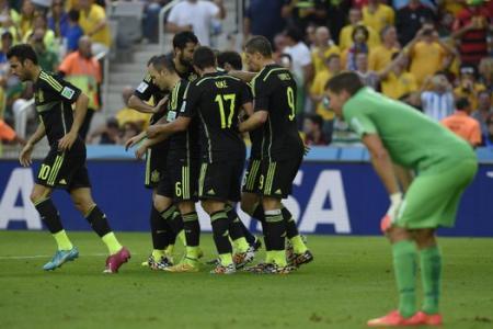 Spain finally registers a win