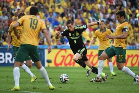 Spain restore pride with win over Australia