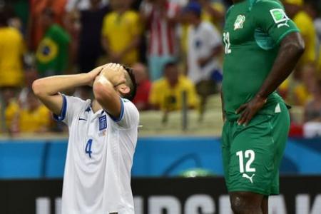 Last minute penalty sends Greeks through