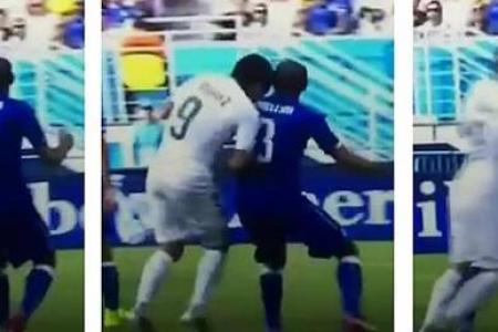 Suarez faces ban after bite on Chiellini