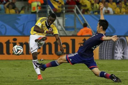 Colombia seal top spot as Japan crash out