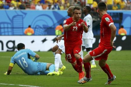 Shaqiri's hat-trick sends Swiss through