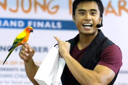 "Manhunt finalist is Singapore's hunkiest ""parrot whisperer"""