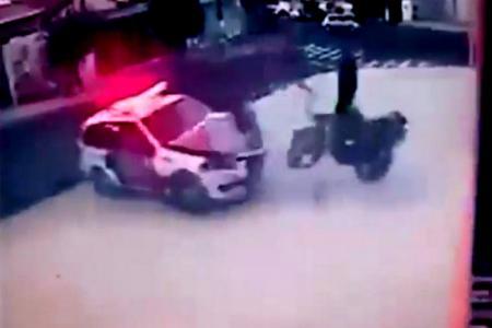 Brazilian police ram fleeing bike, sending riders flying