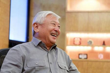 Singapore's first three-star general says he joined up to get away from books